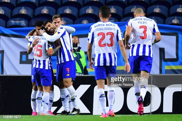Mehdi Taremi of FC Porto celebrates with teammates after scores his sides fourth goal during the Liga NOS match between FC Porto and SC Farense at...