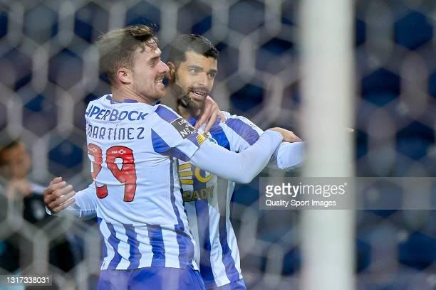 Mehdi Taremi of FC Porto celebrates with Toni Martinez after scoring his team's fourth goal during the Liga NOS match between FC Porto and SC Farense...