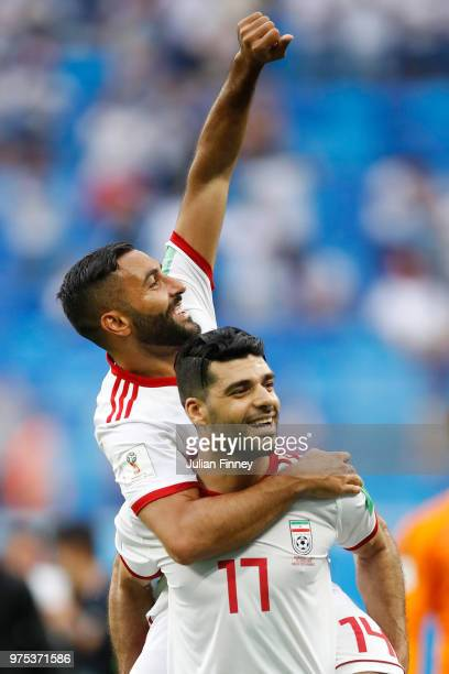 Mehdi Taremi of Iran celebrates his sides victory with teammate Saman Ghoddos after the 2018 FIFA World Cup Russia group B match between Morocco and...