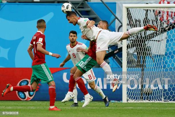 Mehdi Taremi of Iran clashes with Younes Belhanda of Morocco during the 2018 FIFA World Cup Russia group B match between Morocco and Iran at Saint...