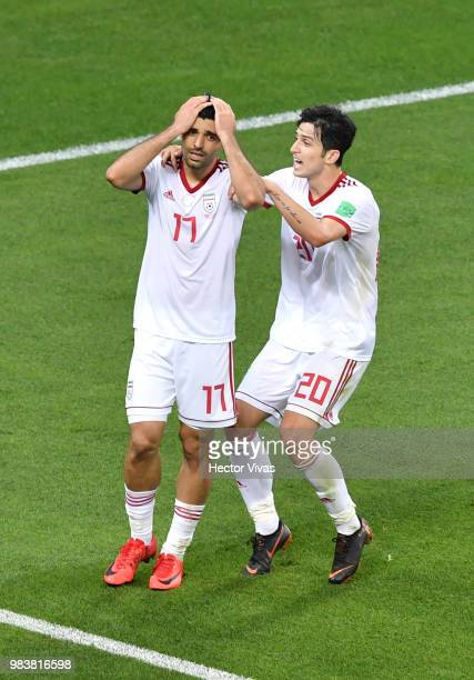 Mehdi Taremi of Iran is consoled by teammate Sardar Azmoun after missing a chance during the 2018 FIFA World Cup Russia group B match between Iran...