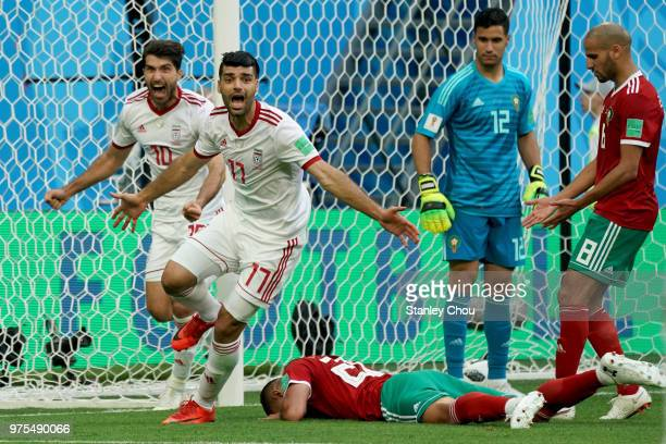 Mehdi Taremi#17 and Omid Ebrahimi of Iran celebrates their first goal against Morocco during the 2018 FIFA World Cup Russia group B match between...