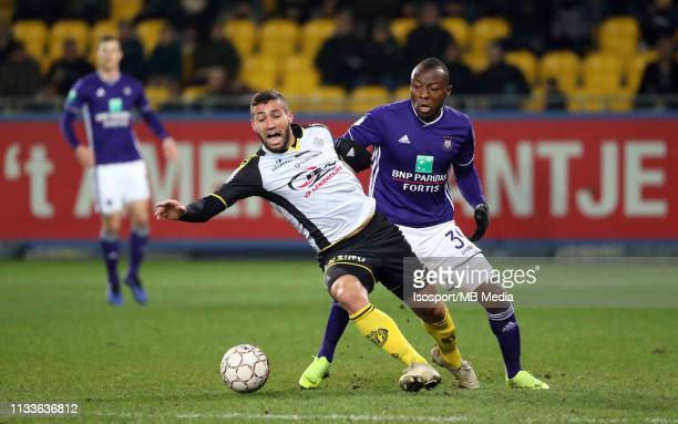 Mehdi Terki of Lokeren and Edo Kayembe of Anderlecht fight for the ball during the Jupiler Pro League match between KSC Lokeren OV and RSC Anderlecht...