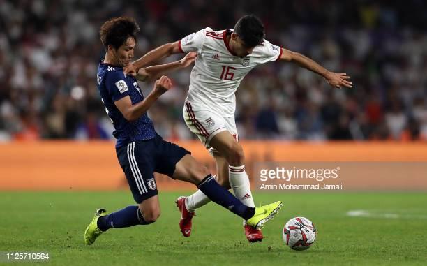 Mehdi Torabi of Irana and Haraguchi Genki of Japan in action during the AFC Asian Cup semi final match between Iran and Japan at Hazza Bin Zayed...