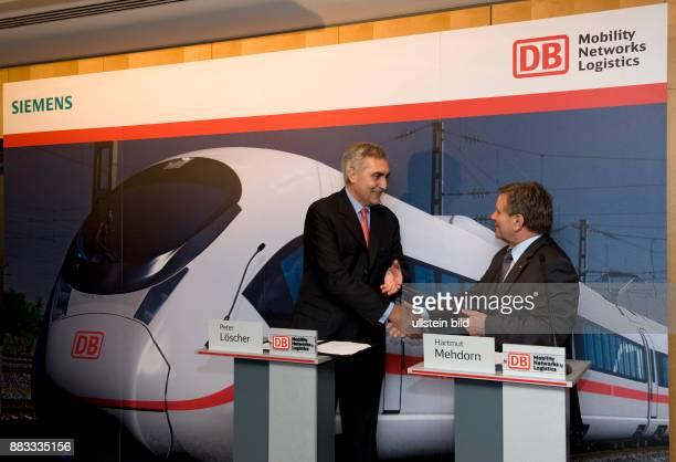 Mehdorn Hartmut Vorstandsvorsitzender Deutsche Bahn AG D mit Peter Loescher Vorstandsvorsitzender der Siemens AG aus Anlass der Bestellung von...