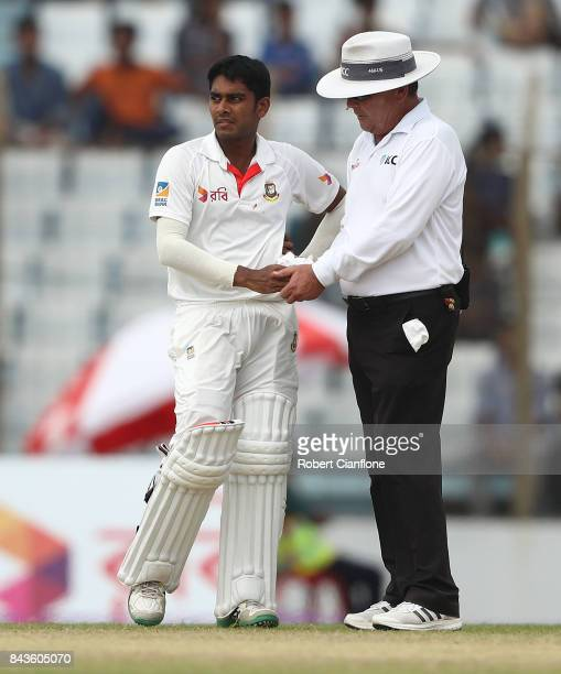 Mehedy Hasan Miraz of Bangladesh has his hand looked at by umpire Ian Gould during day four of the Second Test match between Bangladesh and Australia...