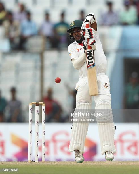 Mehedy Hasan Miraz of Bangladesh is struck by a deliver from Pat Cummins of Australia during day four of the Second Test match between Bangladesh and...