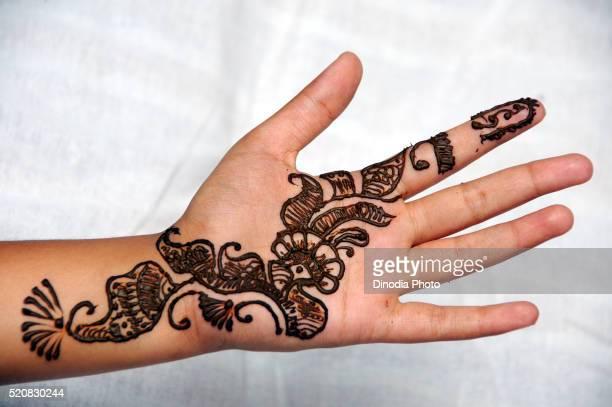 Mehendi design on hand, India