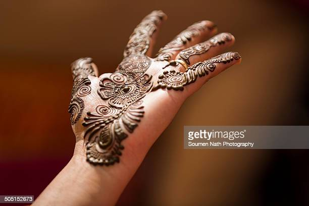 Mehendi design on the palm of an Indian bride