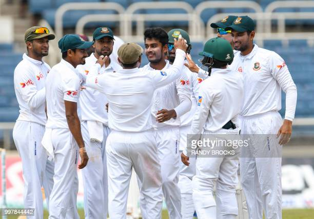 Mehidy Hasan Miraz of Bangladesh congratulated by teammates after taking 5 West Indies wickets for 93 runs during day 2 of the 2nd Test between West...