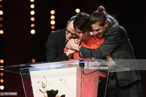 Mehmet Akif Büyükatalay Bastian Klügel and Claus Reichel winner of the GWFF First Feature Award for Oray are seen at stage at the closing ceremony of...