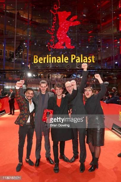 "Mehmet Akif Büyükatalay , Bastian Klügel and Claus Reichel , winner of the GWFF First Feature Award for ""Oray"", pose after the closing ceremony of..."