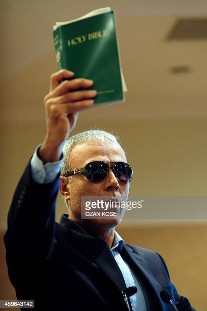 Mehmet Ali Agca Turkish man who attempted to assassinate Pope John Paul II in 1981 holds a copy of the Bible during a press conference in Istanbul on...