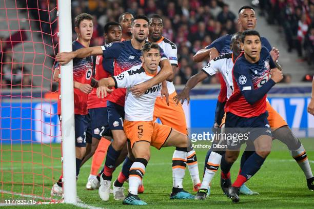 Mehmet CELIK of Lille and Gabriel PAULISTA of Valencia fight during the UEFA Champions League Group H match between Lille and Valencia on October 23...