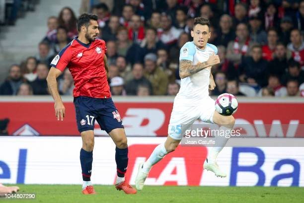 Mehmet Celik of Lille Lucas Ocampos of Marseille during the french Ligue 1 match between Lille OSC and Olympique de Marseille at Stade Pierre Mauroy...