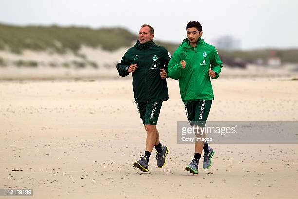 Mehmet Ekici and Matthias Hoenerbach of Bremen practice during the SV Werder Bremen training session on July 4 2011 in Norderney Germany