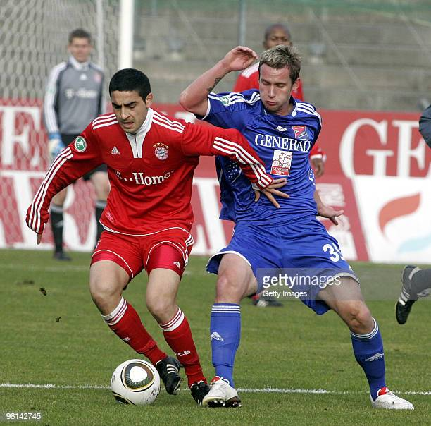 Mehmet Ekici of Bayern II and Manuel Konrad of Unterhaching battle for the ball during the 3Liga match between SpVgg Unterhaching and Bayern Muenchen...