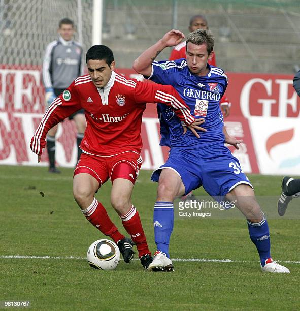 Mehmet Ekici of Bayern Muenchen II and Manuel Konrad of Unterhaching battle for the ball during the 3Liga match between SpVgg Unterhaching and Bayern...