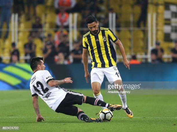 Mehmet Ekici of Fenerbahce in action against Gary Alexis Medel during the Turkish Super Lig week 6 soccer match between Fenerbahce and Besiktas at...