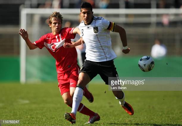 Mehmet Erkut Senturk of Turkey challenges Emre Can of Germany during the UEFA U17 European Championship Elite Round match between Germany and Turkey...