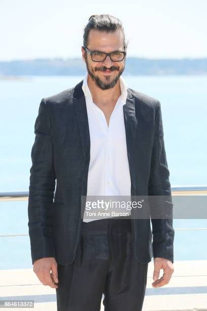 Mehmet Gunsur attends 'Phi' Photocall during MIPTV 2017 on April 3 2017 in Cannes France