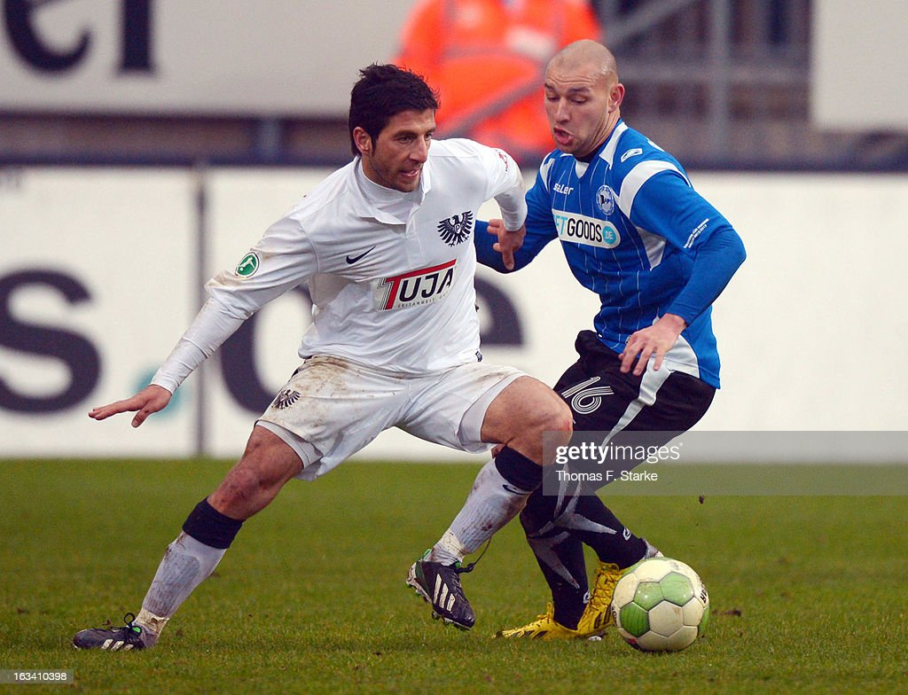 Mehmet Kara (L) of Muenster fights for the ball with Philipp Riese of Bielefeld during the Third League match between Arminia Bielefeld and Preussen Muenster at Schueco Arena on March 9, 2013 in Bielefeld, Germany.