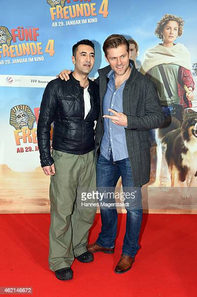 Mehmet Kurtulus and Jens Atzorn attend the premiere of the film 'Fuenf Freunde 4' at Cinemaxx on January 25 2015 in Munich Germany