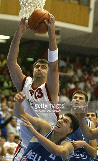 Mehmet Okur from Turkey vies against Greece in a match in group D of the FIBA European Basketball Championships 2003, in Boras, Sweden 06 September...