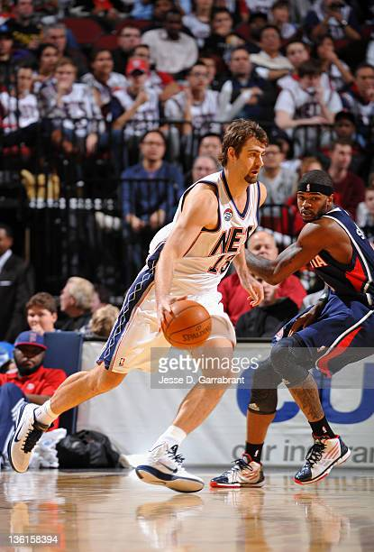 Mehmet Okur of the New Jersey Nets controls the ball during the second half of the home opener against the Atlanta Hawks on December 27 2011 at the...