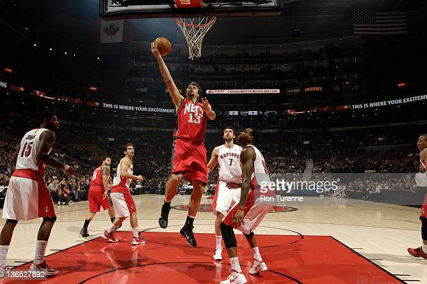 Mehmet Okur of the New Jersey Nets goes to the basket during the game between the Toronto Raptors and the New Jersey Nets on January 6 2012 at the...