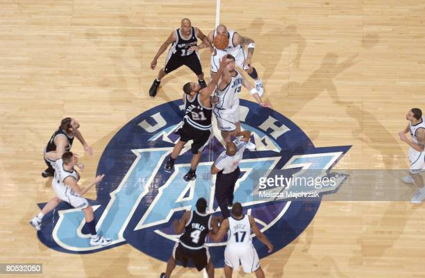 Mehmet Okur of the Utah Jazz and Tim Duncan of the San Antonio Spurs contest each other in the tipoff at EnergySolutions Arena on April 4, 2008 in...
