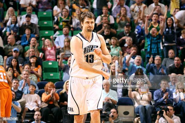 Mehmet Okur of the Utah Jazz cheers after making a threepoint shot against the Phoenix Suns at EnergySolutions Arena on April 14 2010 in Salt Lake...
