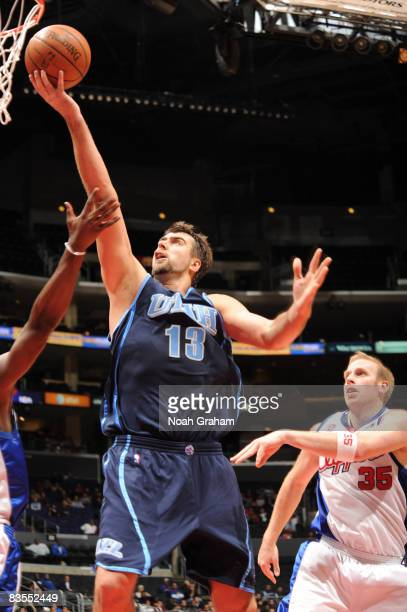 Mehmet Okur of the Utah Jazz goes up for a shot against the Los Angeles Clippers at Staples Center on November 3 2008 in Los Angeles California NOTE...