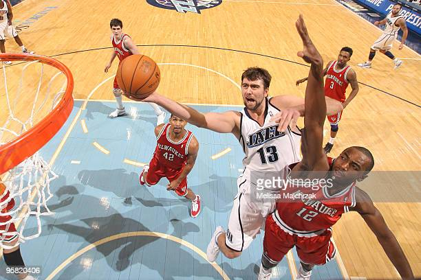 Mehmet Okur of the Utah Jazz goes up for the shot against Luc Mbah a Moute of the Milwaukee Bucks at EnergySolutions Arena on January 16 2010 in Salt...