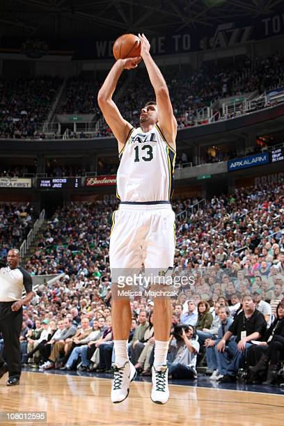 Mehmet Okur of the Utah Jazz goes up for the shot over the defense of the New York Knicks at EnergySolutions Arena on January 12 2011 in Salt Lake...
