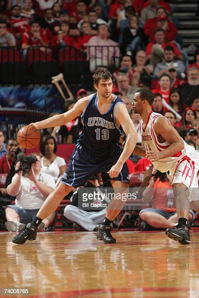 Mehmet Okur of the Utah Jazz moves the ball against Chuck Hayes of the Houston Rockets in Game Two of the Western Conference Quarterfinals during the...