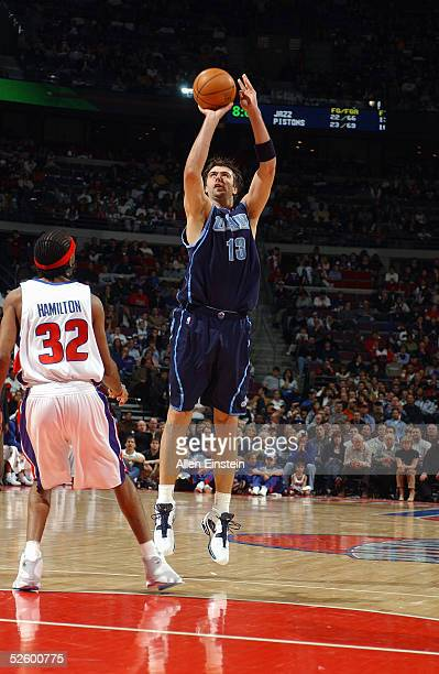 Mehmet Okur of the Utah Jazz shoots over Richard Hamilton of the Detroit Pistons during the game on March 13 2005 at the Palace of Auburn Hills in...