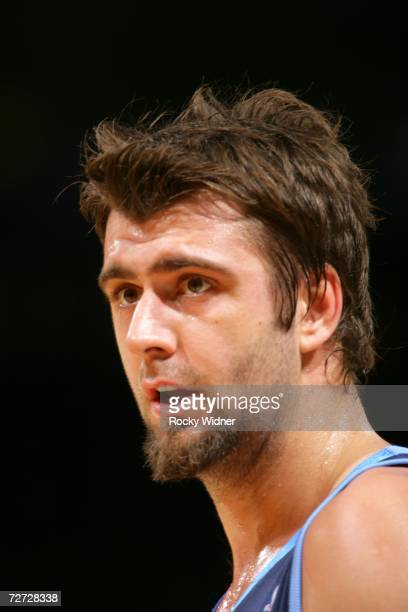 Mehmet Okur of the Utah Jazz watches the game against the Golden State Warriors at the Oracle on November 25 2006 in Oakland California The Warriors...