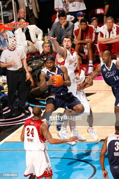 Mehmet Okur of the Western Conference tries to block the shot of LeBron James of the Eastern Conference during the 2007 NBA All-Star Game on February...