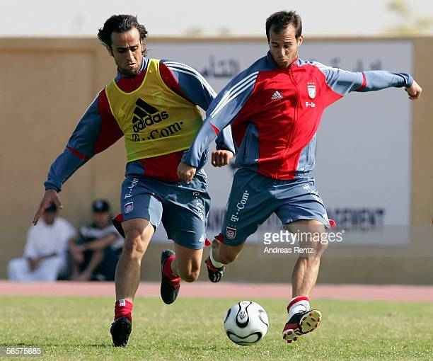 Mehmet Scholl and Ali Karimi of German Bundesliga club Bayern Munich challenge for the ball on January 12 2006 at their training camp in Dubai United...