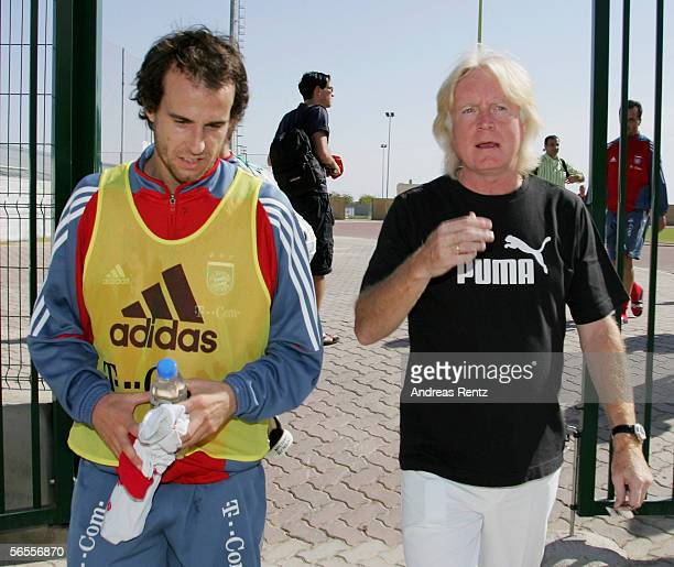 Mehmet Scholl and his former Coach Winfried Schaefer walk from the field during the training camp of German Bundesliga club Bayern Munich on January...