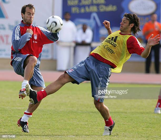 Mehmet Scholl challenges for the ball with Martin Demichelis of Bayern Munich at their training camp on January 12 2006 in Dubai United Arab Emirates