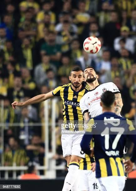 Mehmet Topal of Fenerbahce in action against Alvaro Negredo of Besiktas during Ziraat Turkish Cup Semi Final second leg soccer match between...