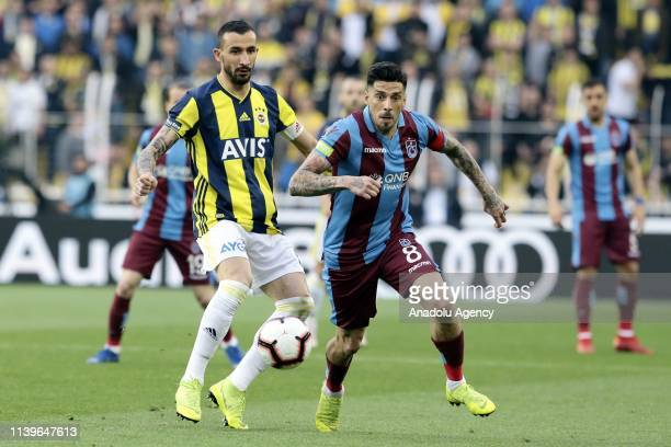 Mehmet Topal of Fenerbahce in action against Jose Sosa of Trabzonspor during Turkish Super Lig week 30 soccer match between Fenerbahce and...