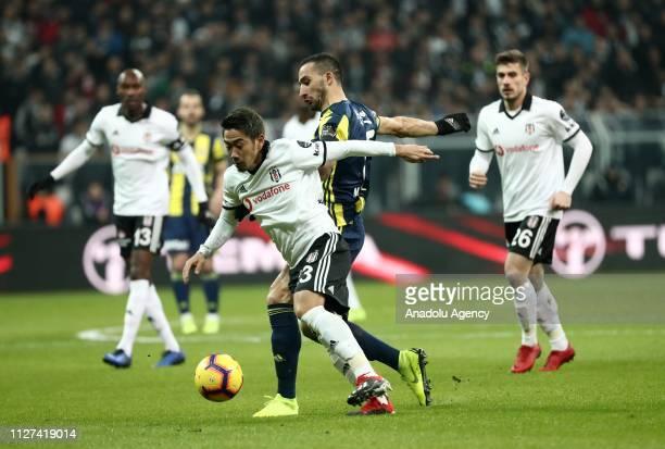 Mehmet Topal of Fenerbahce in action against Shinji Kagawa of Besiktas during Turkish Super Lig soccer match between Fenerbahce and Besiktas at...