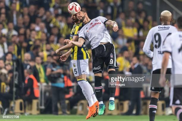 Mehmet Topal of Fenerbahce SK Alvaro Negredo Sanchez of Besiktas JK during the Ziraat Turkish Cup match Fenerbahce AS and Besiktas AS at the Sukru...