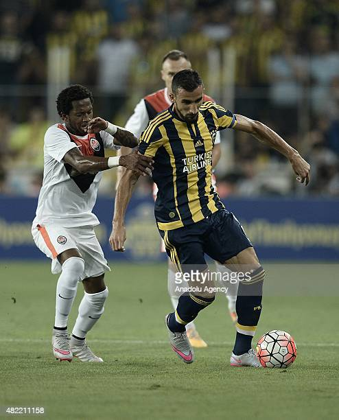 Mehmet Topal of Fenerbahce vies for ball with Frederico Rodrigues Santos of Shakhtar Donetsk during UEFA Champions League Third Qualifying Round 1st...