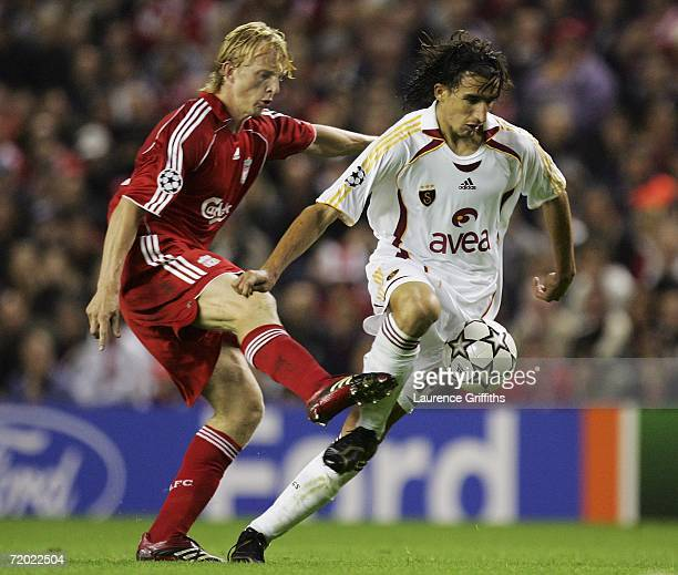 Mehmet Topal of Galatasaray is challenged by Dirk Kuyt of Liverpool during the UEFA Champions League group C match between Liverpool and Galatasaray...
