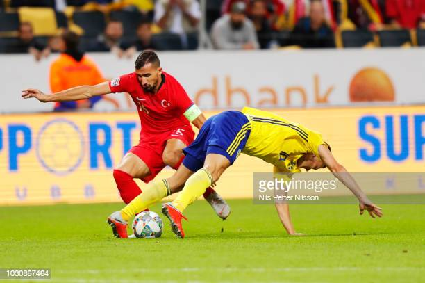 Mehmet Topal of Turkey and Viktor Claesson of Sweden competes for the ball during the UEFA Nations League B group two match between Sweden and Turkey...