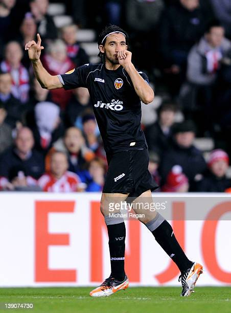 Mehmet Topal of Valencia CF celebrates scoring the opening goal during the UEFA Europa League Round of 32 First leg match between Stoke City and...